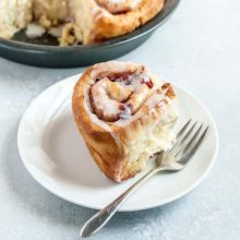 Cherry Vegan Cinnamon Rolls | Cherry vegan cinnamon rolls with the fluffiest rolls and a tart cherry filling! Baked until golden brown and topped with an EASY powered sugar frosting. Find recipe at redstaryeast.com.