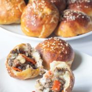 Pretzel Bun Philly Cheesesteak Bombs | All the amazing flavors of a classic Philly Cheesesteak stuffed in a soft 'n chewy pretzel bun! This will quickly become your favorite game day or party snack! Find recipe at redstaryeast.com.