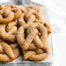 Healthy Mini Soft Pretzels | This recipe yields a much healthier version of my favorite baseball and shopping mall snacks… But they're still just as delicious! Soft on the inside, that lovely brown crust on the outside, and a bright pop from the coarse sea salt. Truly irresistible! Find recipe at redstaryeast.com.
