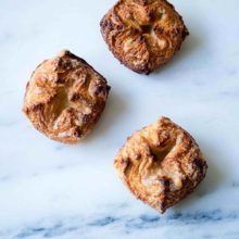"Maple Kouign Amann | Kouign in the native Breton language means cake and Amann, butter. There's no better way to describe this decadent cake unless the natives of Brittany add the local word ""flaky"" to the mix. Find recipe at redstaryeast.com."