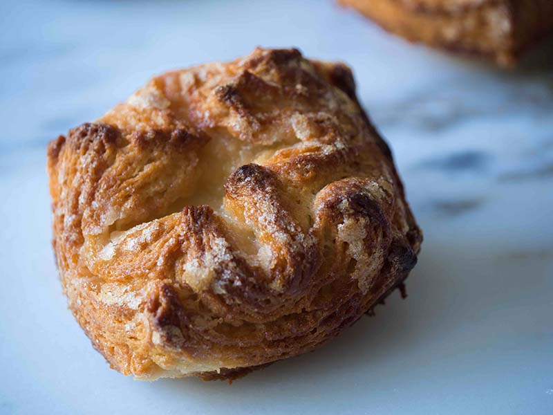 """Maple Kouign Amann   Kouign in the native Breton language means cake and Amann, butter. There's no better way to describe this decadent cake unless the natives of Brittany add the local word """"flaky"""" to the mix. Find recipe at redstaryeast.com."""