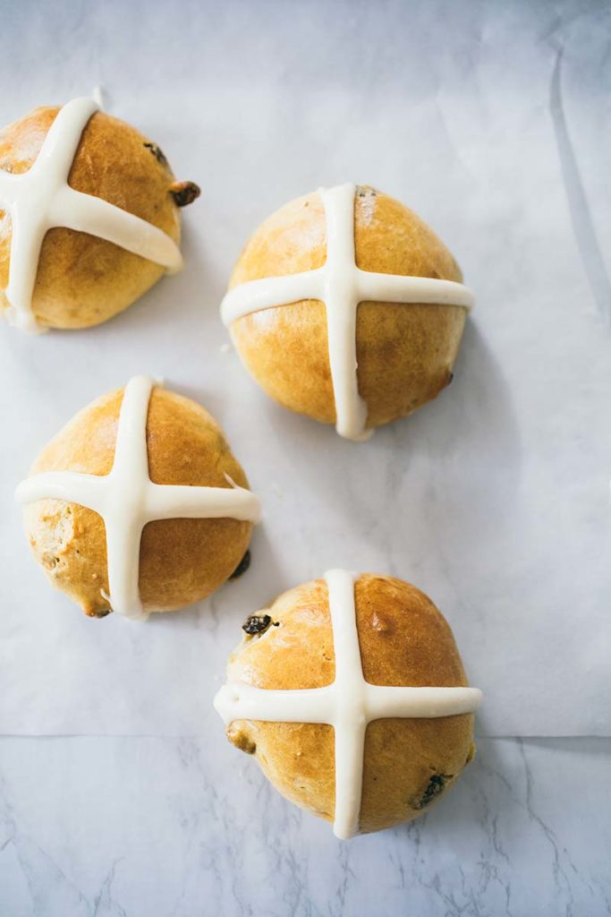 Hot Cross Buns | A sweet dough, spiced, studded with dried (sometimes candied) fruit and decorated with a cross made of icing. Find recipe at redstaryeast.com.