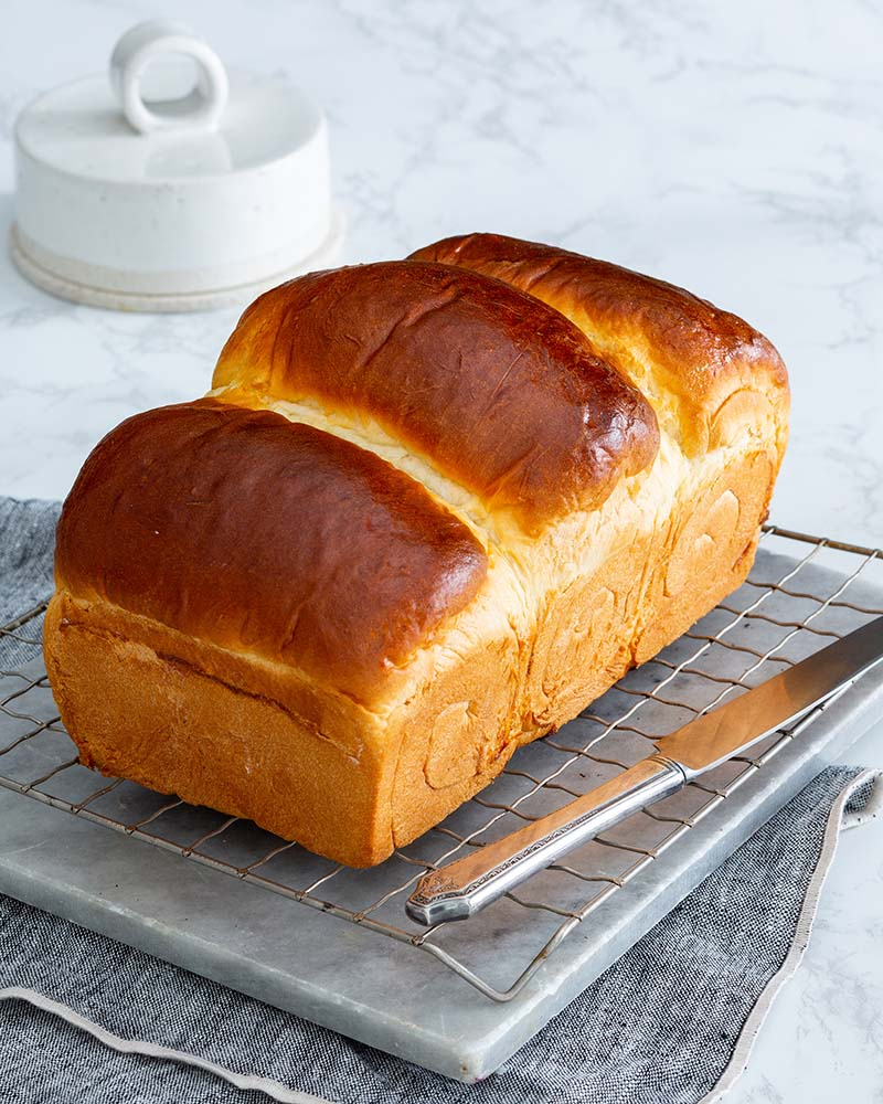 Milk Bread | Commonly found in Asian bakeries, this pillow-soft bread uses Tangzhong to render three tall, spiraled loaves that are airy and delicately sweet, taking your everyday toast to the next level. Find recipe at redstaryeast.com.