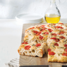 With a chewy interior and an addictive caramelized crust adorned with fresh grape tomatoes, this rosemary-scented focaccia has all the tangy comfort of sourdough but without the hassle, thanks to Platinum Instant Sourdough Yeast.