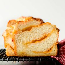 Homemade Cheese Bread | This homemade cheese bread features ripples and swirls of real melted cheese and a deliciously soft and buttery dough. It's irresistible! Find recipe at redstaryeast.com.