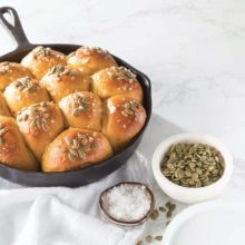 Platinum Instant Sourdough Pumpkin Rolls | Combining the pleasant tang of sourdough with mildly sweet pumpkin and baked in a cast-iron skillet, these bread rolls embody fall comfort baking at its finest. We finished them off with a savory topping of pepitas and flaked sea salt, delivering a welcome note of crunch to the rolls' pillowy perfection. Find recipe at redstaryeast.com.
