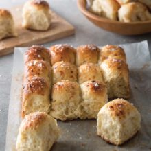 Pull-Apart Rolls | Peppery, freshly grated Comté cheese and Caramelized Shallots team up for a flavor blowout in these hearty rolls. This method is a cinch. Throw these Pull-Apart Rolls on a platter, and watch everyone tear off their own piece of pillowy perfection. Find recipe at redstaryeast.com.