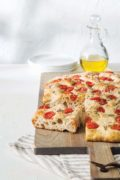 Platinum Instant Sourdough Tomato Focaccia | With a chewy interior and an addictive caramelized crust adorned with fresh grape tomatoes, this rosemary-scented focaccia has all the tangy comfort of sourdough but without the hassle, thanks to Platinum Instant Sourdough Yeast. Find recipe at redstaryeast.com.
