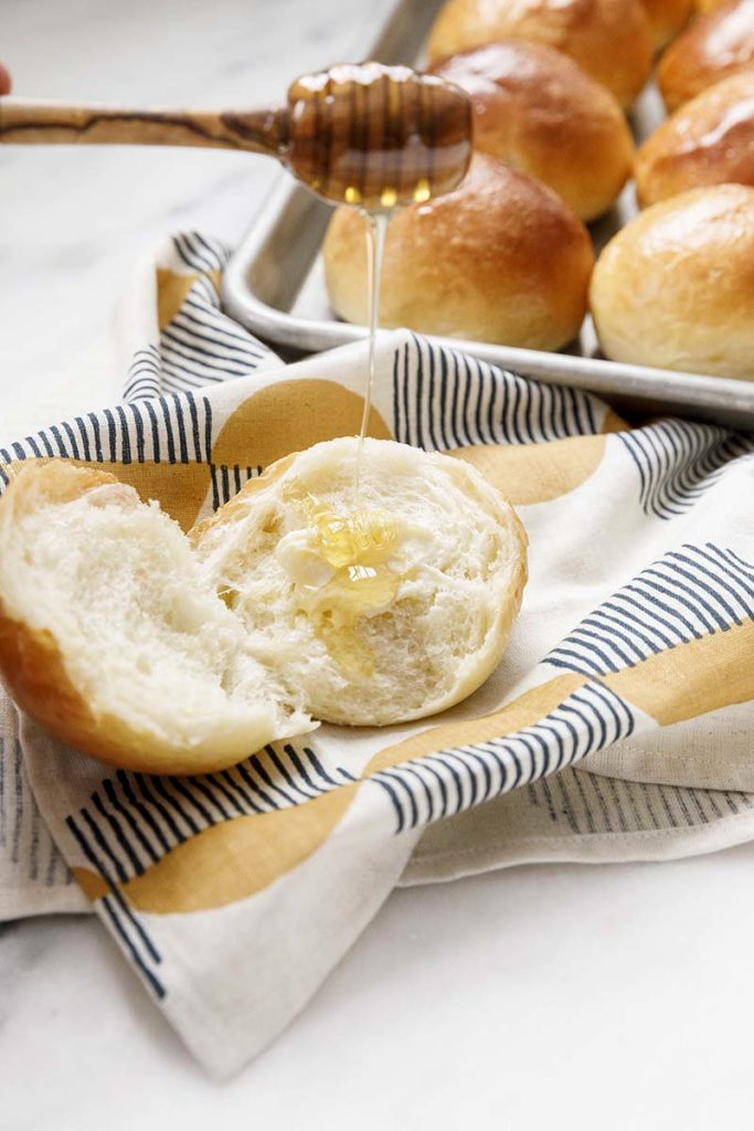 Milk Bread Honey Buns | These honey buns are extra special because they use a tangzhong to make them super light, fluffy and tender. Find recipe at redstaryeast.com.