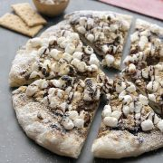 S'mores Grilled Pizza | Start a new summer tradition with this homemade dessert pizza. Made with a grilled artisan pizza crust and all the traditional s'mores fixings plus a layer of chocolate hazelnut spread. The perfect dessert with your family or for your next get-together! Find recipe at redstaryeast.com.