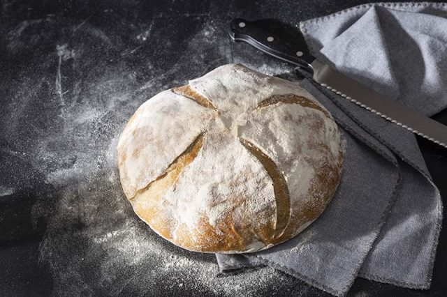 Country Loaf | A classic French country bread gets shaped into a boule and baked in a Dutch oven for home baking ease. Made with both bread flour and whole wheat flour for texture, it boasts a crusty exterior and moist interior. Find recipe and shaping video at redstaryeast.com.