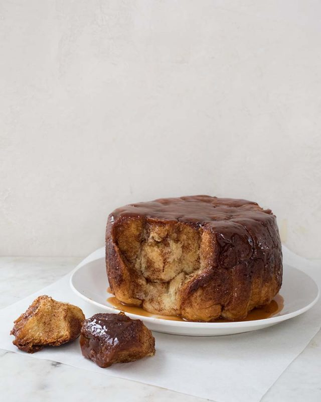 Slow Cooker Monkey Bread | Soft and rich brioche no-knead dough pieces coated with a cinnamon-sugar mixture and topped with caramel sauce. Baked in a slow cooker, this monkey bread is an easy and fun baking project for the kids. Find recipe at redstaryeast.com.