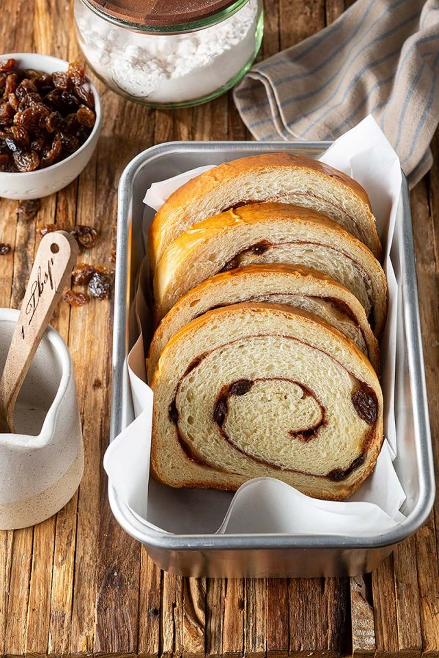 Homemade Cinnamon Raisin Swirl Bread | Filled with sugar and raisins, this buttermilk dough gets rolled to perfection for a visually stunning swirl. Get recipe at redstaryeast.com.