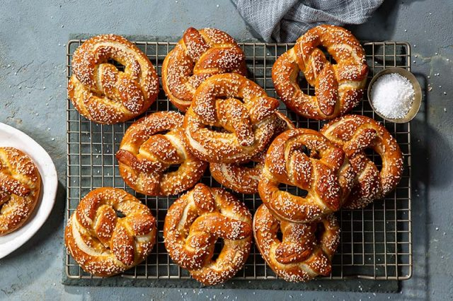 Homemade Soft Pretzels | These soft pretzels get boiled in baking soda water for their signature chewy texture, flavor, and deep color. Find recipe and shaping video at redstaryeast.com.