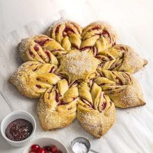 Cranberry Raspberry Star Bread | This show-stopper bread is so easy to make! A simple no-knead enriched dough layered with almond and cranberry-raspberry filling, this beautiful star bread is perfect for holiday celebrations or an everyday treat. Get recipe and video tutorial at redstaryeast.com.