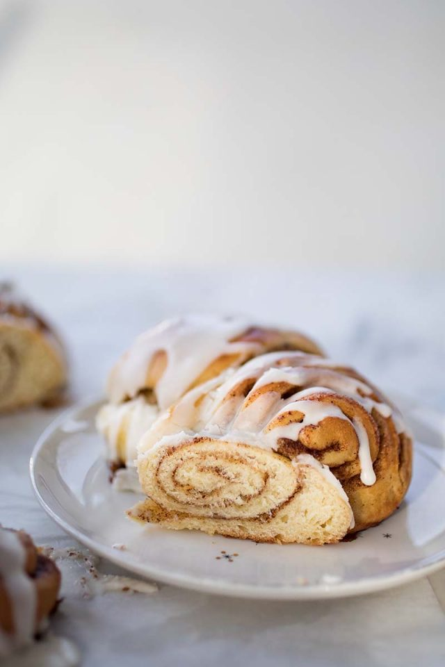 Cinnamon Roll Tea Ring with Egg Nog Glaze | This tea ring is an ultra fancy cinnamon roll, baked as wreath and topped with an Eggnog Glaze. The cuts and twists of the dough make for a super-festive bread that is actually really easy to make, so don't leave this one just for the holidays. Get recipe at redstaryeast.com.
